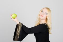 Beautiful fashion model holding an apple Royalty Free Stock Photo