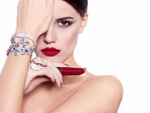 Beautiful and fashion model. Beautiful fashion model on isolated white background with lipstick in hand Stock Image