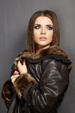Beautiful fashion model , leather fur clothes. Young woman Stock Photography