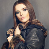 Beautiful fashion model , leather fur clothes. Young woman Stock Image