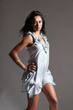 Beautiful fashion model in light blue short dress Royalty Free Stock Photos