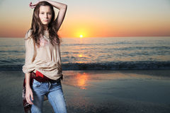 Beautiful fashion model posing at the beach. Stock Photography