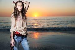 Beautiful fashion model posing at the beach. Stock Photography