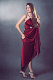 Beautiful fashion model posing in elegant red dress Royalty Free Stock Photos