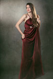 Beautiful fashion model posing in elegant red dress Stock Photo
