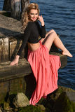Beautiful fashion model posing at old ocean pier Stock Photography