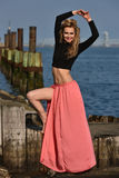 Beautiful fashion model posing at old ocean pier location. Stock Photography