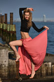 Beautiful fashion model posing at old ocean pier location. Stock Images