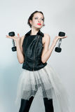 Beautiful fashion model posing with two dumbbells Royalty Free Stock Photography