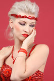 Beautiful fashion model in red Stock Photos