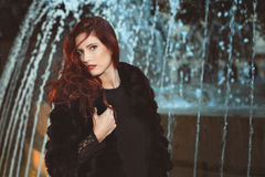 Beautiful fashion model with red hair Royalty Free Stock Photo