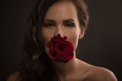 Beautiful fashion model with red rose Stock Photos