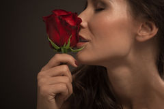 Beautiful fashion model with red rose Stock Image