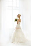 Beautiful fashion model. Sensual bride. Woman with wedding dress Stock Images