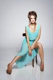 Beautiful fashion model sitting Stock Photos
