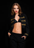 Beautiful fashion model wearing black gold jacket Royalty Free Stock Photography