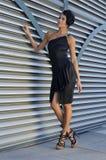 Beautiful fashion model wearing couture black dress Royalty Free Stock Image
