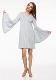 Beautiful fashion model wearing silver dress Stock Photography
