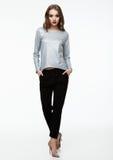 Beautiful fashion model wearing silver top Stock Photos