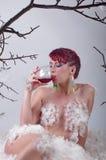 Beautiful fashion model woman drinking red wine Royalty Free Stock Image