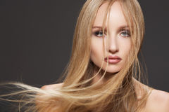 Beautiful fashion model woman with long shiny hair. Wellness, cosmetics and hairstyle. Portrait of beautiful woman model with shiny flying long straight hair on Stock Images