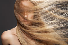 Beautiful fashion model woman with long shiny hair. Wellness, cosmetics and hairstyle. Portrait of beautiful woman model with shiny flying long straight hair on royalty free stock photography