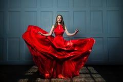 Beautiful Fashion Model Woman in Red Silky Dress. Beautiful Woman, Full Portrait stock photo