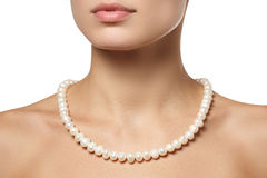 Beautiful fashion pearls necklace on the neck. Jewellery and bijouterie Stock Images