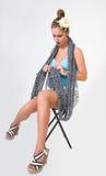 Beautiful fashion pin up woman knitting scarf Royalty Free Stock Images