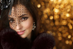 Beautiful fashion retro smiling woman wearing in hat with veil a Stock Image