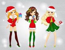 Beautiful Fashion Santa Girls Holding Presents Stock Photos