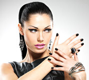 Beautiful fashion woman with black nails at pretty face royalty free stock photos