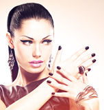 Beautiful fashion sexy woman with black nails at pretty face Royalty Free Stock Image