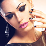 Beautiful fashion sexy woman with black nails at pretty face Royalty Free Stock Photo