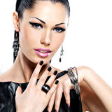 Beautiful fashion woman with black nails at pretty face Stock Images