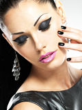 Beautiful fashion woman with black nails at pretty face Stock Photography