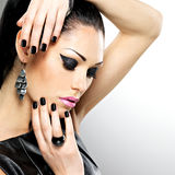 Beautiful fashion sexy woman with black nails at pretty face Stock Image