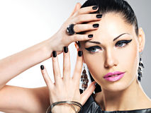 Beautiful fashion sexy woman with black nails at pretty face Stock Photos