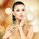 Beautiful fashion woman with black makeup and golden manicure. Portrait of the beautiful fashion woman with black makeup and golden manicure Royalty Free Stock Photography