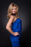 Beautiful fashion woman in blue suit Stock Image
