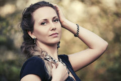 Beautiful fashion woman with a braid hairstyle walking outdoor Royalty Free Stock Images