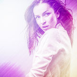 Beautiful fashion woman. Color face pop art photo toned pink. Stock Photo