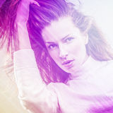 Beautiful fashion woman. Color face pop art photo toned pink. Royalty Free Stock Photography