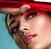 Beautiful fashion woman with a colored items. Attractive white girl with living coral makeup royalty free stock photos