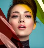Beautiful fashion woman with a colored items. Attractive white girl with living coral makeup royalty free stock photography