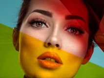 Beautiful fashion woman with a colored items. Attractive white girl with living coral makeup stock photos