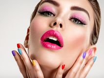 Beautiful fashion woman with a colored nails. Attractive white girl with multicolor manicure royalty free stock photography