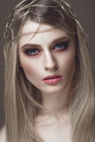 Beautiful fashion woman with creative make-up and hairstyle. beauty face. Beautiful fashion woman with creative make-up and hairstyle. The beauty of the face royalty free stock photos