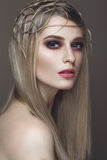 Beautiful fashion woman with creative make-up and hairstyle. beauty face. Beautiful fashion woman with creative make-up and hairstyle. The beauty of the face stock photography
