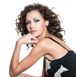 Beautiful fashion woman with curly hair. Beautiful fashion woman with glamour makeup and curly hair. Isolated on white royalty free stock photography